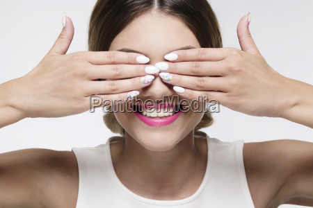 beauty woman smiling hiding her eyes