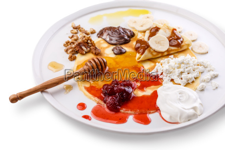 crepes on a dish with various