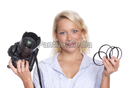 photographer holding a camera and a