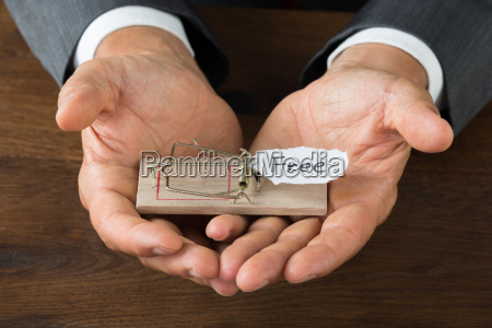 businessman holding rattrap with free sign