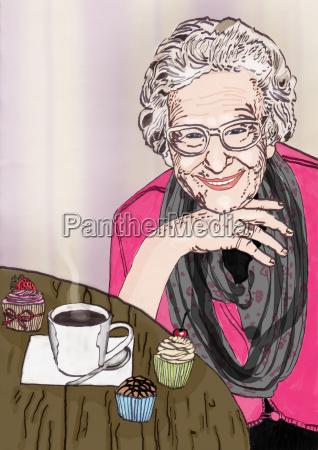przyjazna babcia siedzi przy stole z