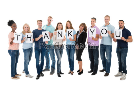 creative business people holding thank you