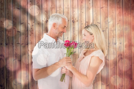 composite image of affectionate man offering