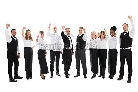 portret happy restaurant staff obchodzi sukces