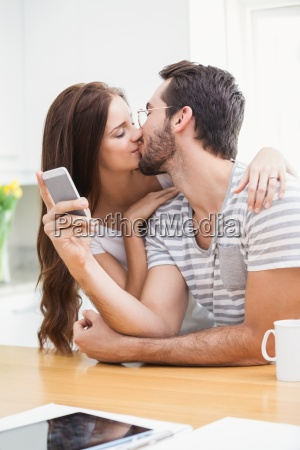 young man using smartphone while girlfriend