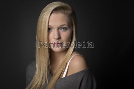 blonde girl in the portrait looks