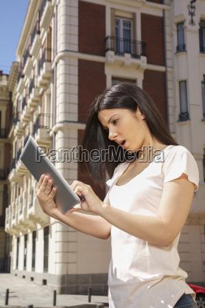 woman watching digital tablet