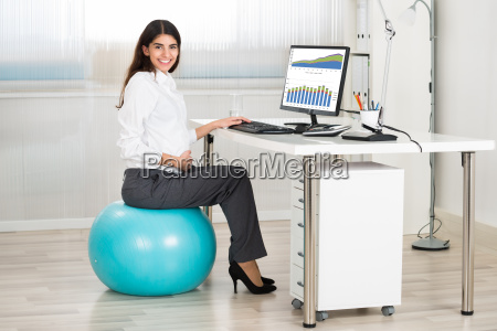 pregnant woman using computer while sitting