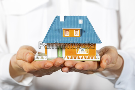 house in human hands concept of