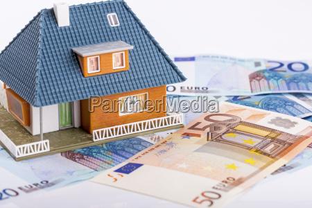 miniature house model on euro money
