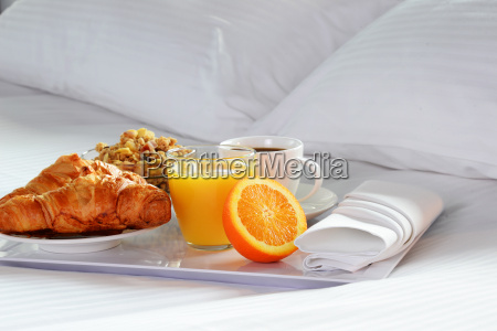breakfast in bed in hotel room