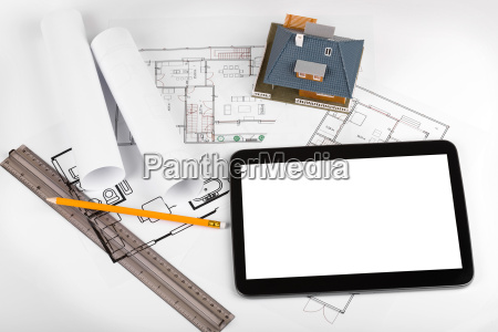 blank tablet and house scale model