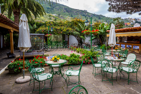 sunny terrace with chairs and a