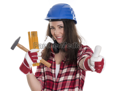 woman with helmet and tools showing