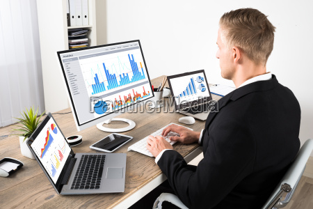 businessman analyzing graphs in office
