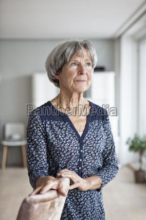 portrait of pensive senior woman at