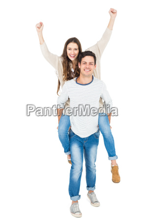 man giving piggy back to his