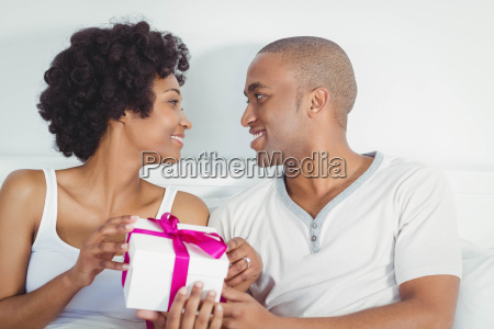 handsome man giving present to his