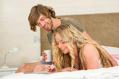 handsome man having coffee while girlfriend