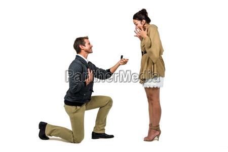 man offering engagement ring to partner