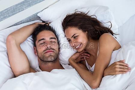 smiling woman looking at man relaxing
