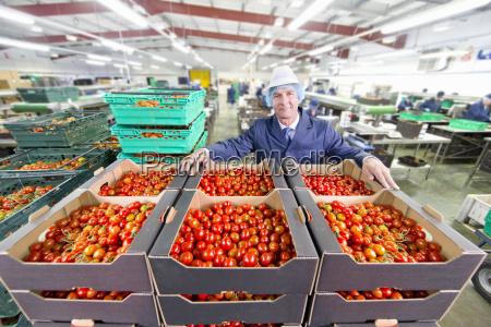 portrait confident quality control worker behind