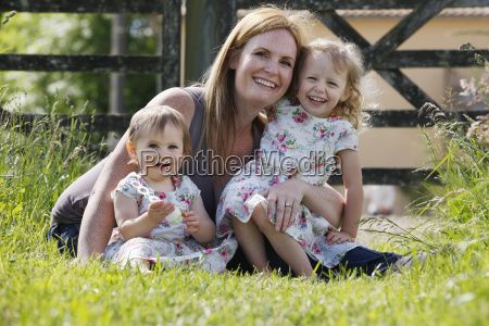 portrait of mother and daughters sitting