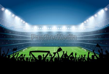 podekscytowany tlum ludzi na stadionie pilkarskim