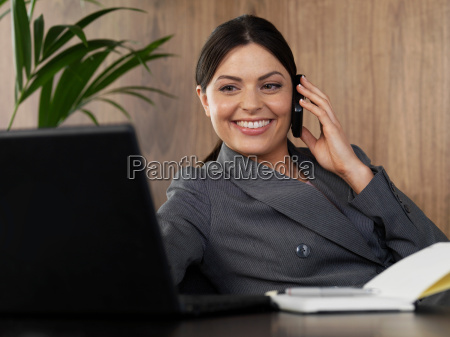 business woman on the phone in