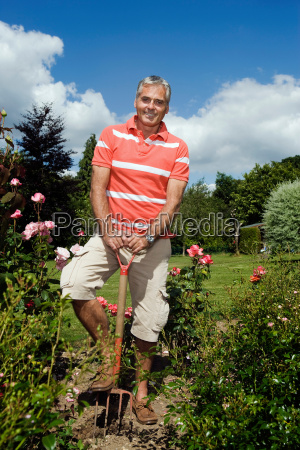 portrait of male gardener with spade