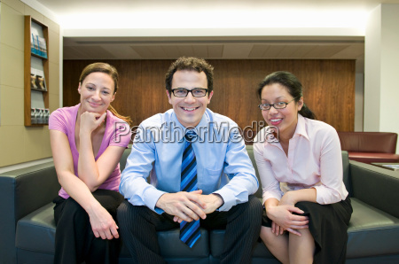 portrait of three business people