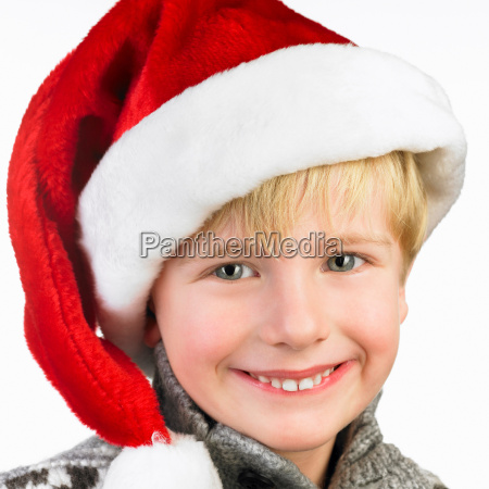 boy wearing a christmas hat