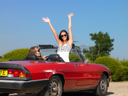 freshly married couple in car goodbye
