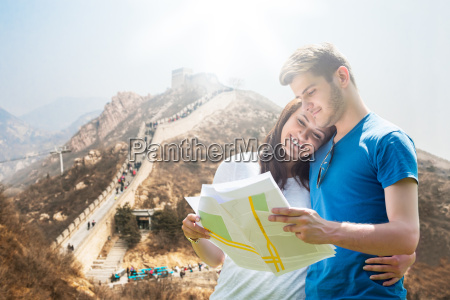 young couple looking at map