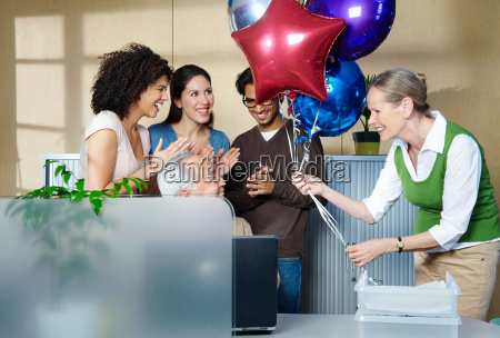 group of people celebrating co worker