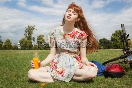 woman relaxing in park