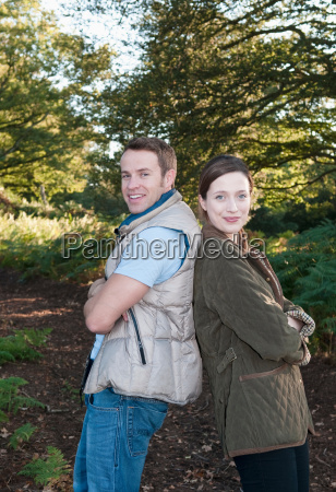 couple, standing, back-to-back, in, park - 18285244