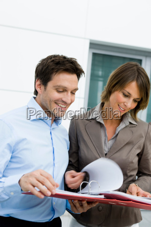man and woman reading a file