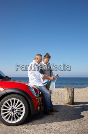 mature couple looking at map by