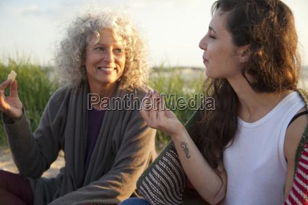 two women having picnic on bournemouth