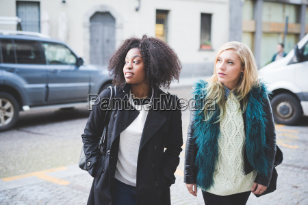 two young female friends on street