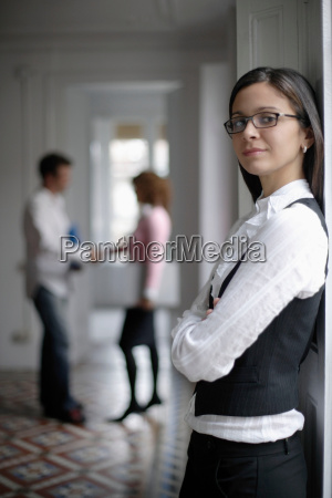 business woman standing by window