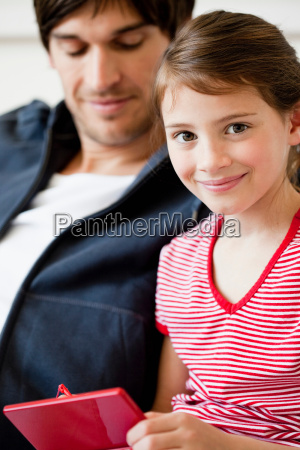 father and girl playing video game
