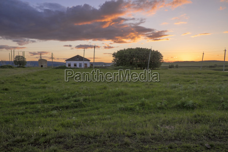 sunset view of field with distant