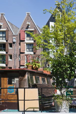 building and boat in amsterdam