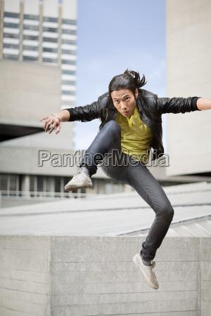 a young man kicking