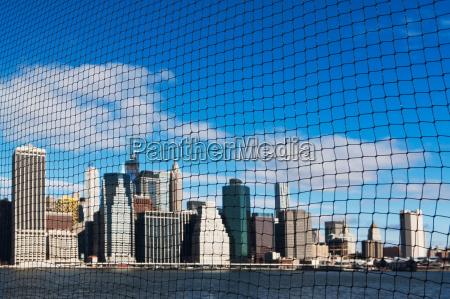 view of manhattan skyline through netting