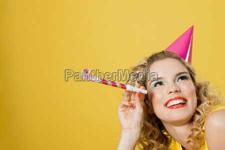 young woman wearing party hat with