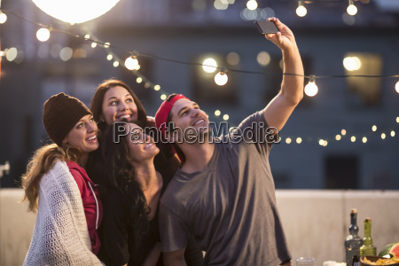 young adult friends taking self portrait