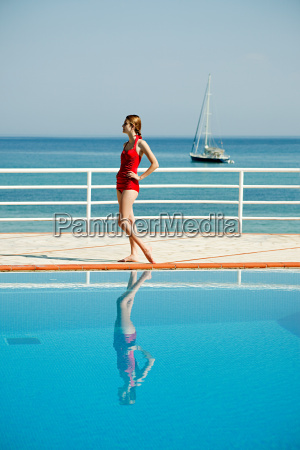 young woman by swimming pool portrait